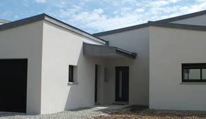 Casas de estilo moderno de ATELIER POTENTIEL