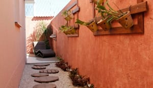 Residência em Jundiaí: Jardins de inverno rústicos por Carol Abumrad Arquitetura e Interiores