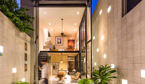 eclectic Houses by Taller Estilo Arquitectura