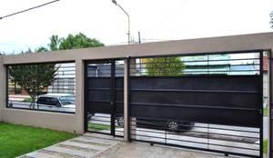 Garage: Garajes de estilo moderno por epb arquitectura