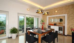 Comedores de estilo moderno de Savio and Rupa Interior Concepts