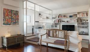 Appartamento ad Ostiense - Roma: Soggiorno in stile in stile Industriale di Archifacturing