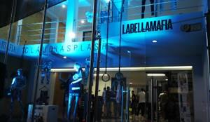 LOCAL COMERCIAL LABELLAMAFIA: Centros comerciales de estilo  por ION arquitectura SAS