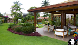 VARANDA : Casas tropicais por Tânia Póvoa Arquitetura e Decoração