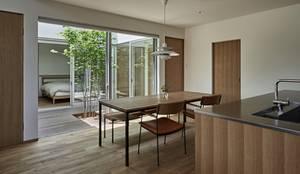 ホワイエのある家: toki Architect design officeが手掛けたダイニングです。