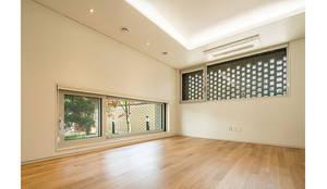 진관동주택: 제이에이치와이 건축사사무소의  침실