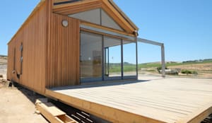 50m2 Sugar Gum Cladded home with decking - work in progress.: scandinavian Houses by Greenpods