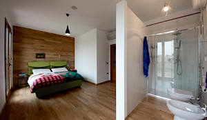Dormitorios de estilo  por Salvo Lombardo Architetto