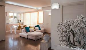 Salones de estilo moderno de manuarino architettura design comunicazione