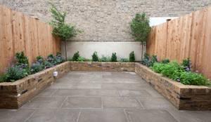 Jardines de estilo moderno por Orchestrate Design and Build Ltd.