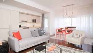Apartamento com vista para Lisboa Homestaging: Salas de estar  por Margarida Bugarim Interiores