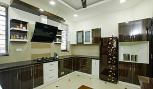A Young & Youthful Design: classic Kitchen by Premdas Krishna