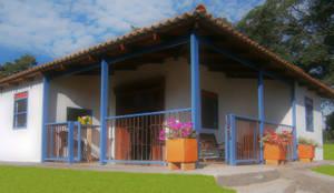 casa cafetera: Casas de estilo rural por Construexpress