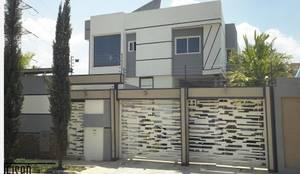Fachada Frontal exterior: Casas de estilo escandinavo por Eisen Guerrero Arquitecto