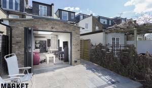 Gorgeous bi-fold doors opening onto patio/garden: modern Garden by The Market Design & Build