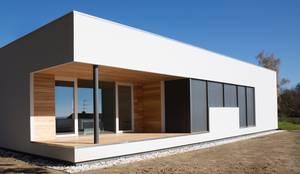 Projekty, nowoczesne Domy zaprojektowane przez Studio Ecoarch