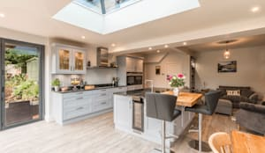 High Peak.  Stunning views of the High Peak countryside from this family room extension: modern Kitchen by John Gauld Photography