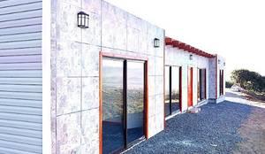 Casas prefabricadas de estilo  por Constructora Milan,