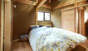 長崎 五島 / 伝統工法の小さな家: HAGが手掛けた寝室です。