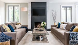 Modern comforts:  Living room by Frahm Interiors,