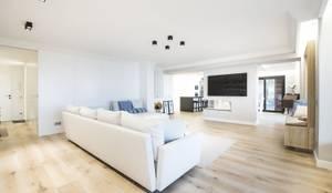 Iluminación vivienda en Tarragona: Salones de estilo moderno de Luxiform Iluminación
