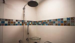Apartamento Angarita Yañiez: Baños de estilo  por AMR estudio