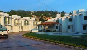 Conjunto habitacional El Palmar: Casas multifamiliares de estilo  por D&E-ARQUITECTURA