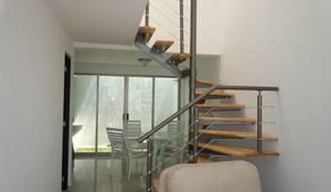 El palmar: Escaleras de estilo  por D&E-ARQUITECTURA