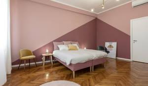 Camera matrimoniale: Camera da letto in stile in stile Moderno di Architrek