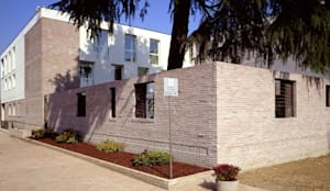 MUNICIPIO A TRUCCAZZANO: Case in stile in stile Moderno di Arco Associati srl