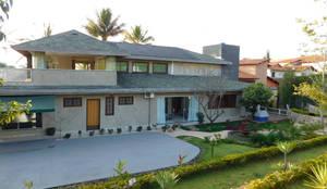 Casa MO : Casas familiares  por Efeito Arquitetura