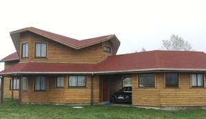 Fachada Norte: Chalets de estilo  por Nomade Arquitectura y Construcción spa
