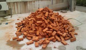 披薩窯製作材料 - 磚塊:  餐廳 by 安居住宅有限公司