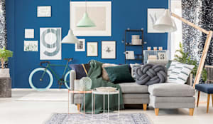 An eclectic design of furniture and home décor accessory pieces:  Living room by Rebel Designs