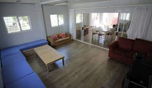 Container Housing For Ubuntu Football Club: rustic Living room by Container Rental and Sales (Pty) Ltd