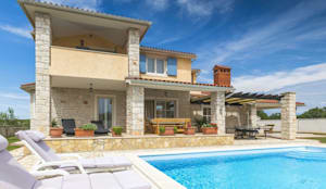 Diseño y construcción de casas en Málaga: Casas de estilo clásico de Klausroom