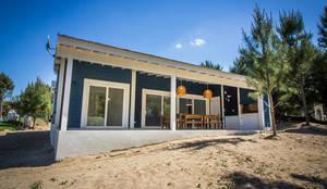 Casa 390 Deportivo por JOM HOUSES: Casas unifamiliares de estilo  por JOM HOUSES,