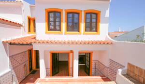 Renovação de moradia: Casas unifamilares  por MP Construction Management