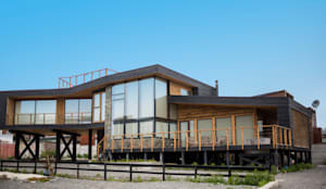 Vivienda Maria Salah: Casas de madera de estilo  por Kimche Arquitectos ,