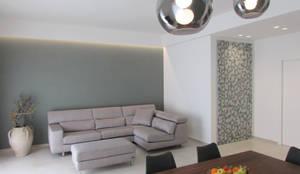 living: Pareti in stile  di B+P architetti