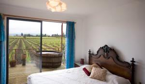 Vivienda Ecoloft Curicó: Dormitorios de estilo  por INFINISKI,