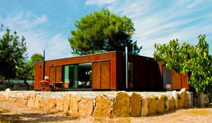Fachada Principal: Casas ecológicas de estilo  por INFINISKI
