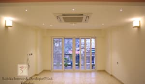 Living room with large windows:  Living room by Rishika Interior & Developer (p) Ltd.
