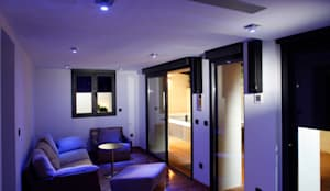 Sala de estar con sistema de audio integrado: Salones de estilo  de Domonova Soluciones Tecnológicas para tu vivienda en Madrid