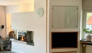3-seitig geöffneter Kamin:  Wohnzimmer von Christoph Lüpken Ofenbau GmbH - Kamine aus Duesseldorf
