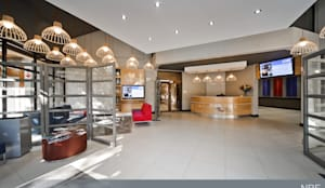 After: Modern reception area.:  Office buildings by Nuclei Lifestyle Design