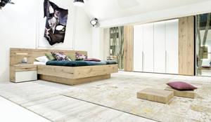Mobilier de chambre haut de gamme en chêne massif, design allemand: Petites chambres de style  par Imagine Outlet, Moderne Bois Effet bois