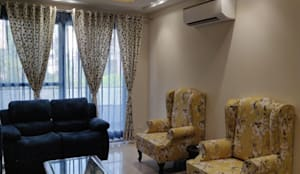 Living Room with 4 seater Sofa, 2 seater recliner, 2 seater Couch and 2 wing chairs along:  Living room by Design Kreations