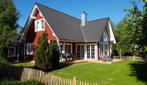 """Schwedenhaus """"Björkö"""" - Ferienhaus mit nordischem Charme:  Holzhaus von Skan-Hus Projekt GmbH"""