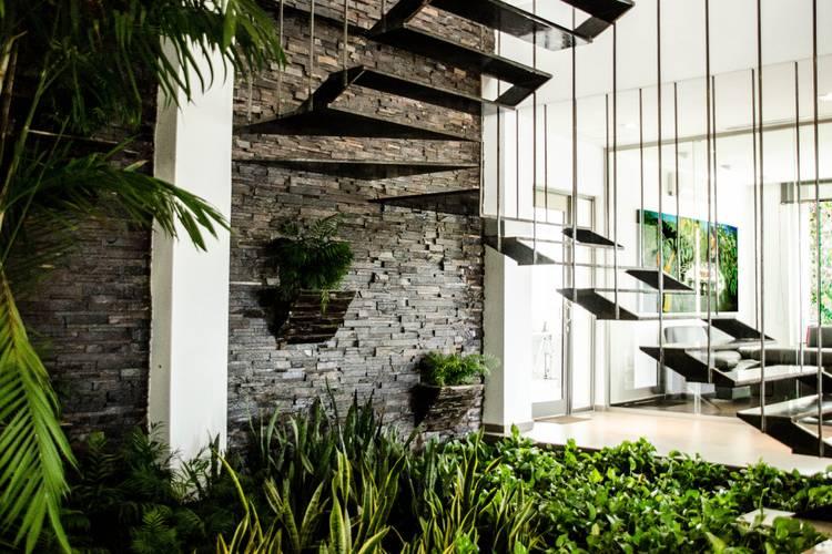 modern Corridor, hallway & stairs by ARKOT arquitectura + construcción